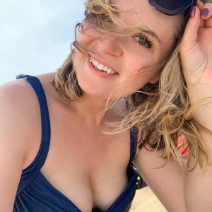Books and beach swim suit